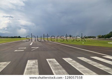 BALI - JANUARY 04: Runway at Denpasar International Airport on January 4, 2013 in Bali, Indonesia. Airport capacity is growing, planned to reach maximum of 20 mln travelers by 2017.