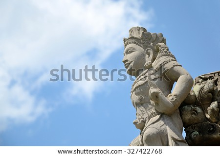 Bali style sculpture and blue sky in hindu temple at indonesia