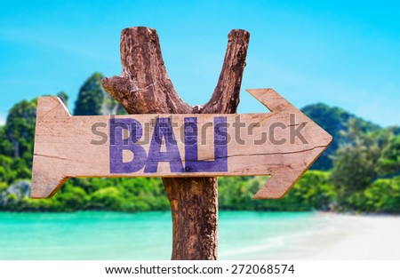 Bali wooden sign with beach background - stock photo