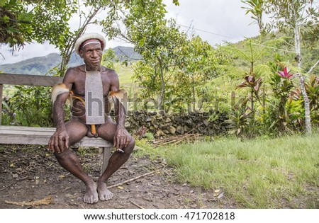 Baliem Valley, West Papua, Indonesia, February 15th, 2016: Dani tribe man smoking
