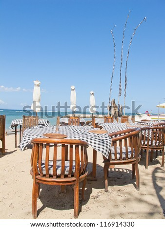 Balinese Jimbaran beach famous for it's perfect sea food restaurants - stock photo