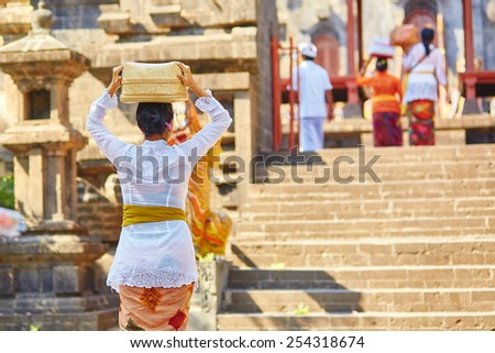 Balinese people going to the temple with offerings - stock photo