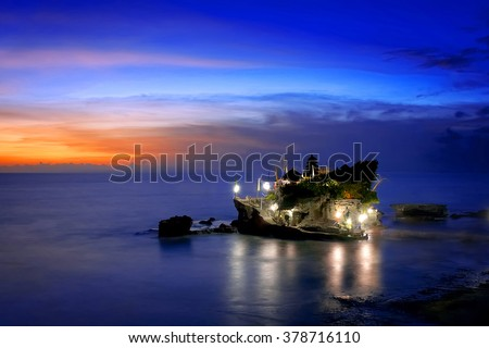 Balinese Temple In The Sunset - Tanah Lot Bali. A beautiful landscape of hinduism temple located in Tanah Lot Bali during yearly ritual - stock photo