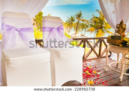 balinese wedding ceremony with palm background - stock photo