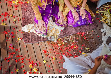 balinese wedding ceremony with sitting in the gazebo newlyweds - stock photo