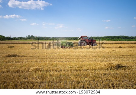 Baling work with tractor - stock photo