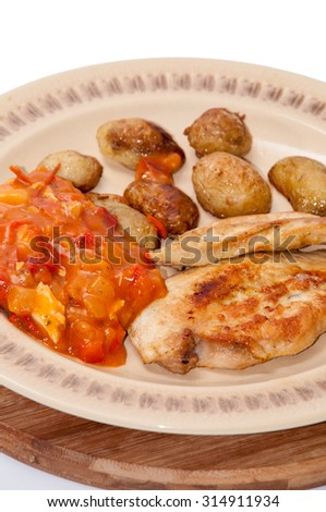 Balkan tomato stew with fried chicken and pork meat. - stock photo