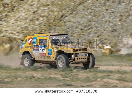 BALKHASH, KAZAKHSTAN-JULY 13, 2016: Sports car gets over the difficult part of the route during the Silk Way rally Moscow-Beijing Dakar series on a dirt road