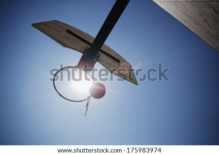 Ball About To Go Through Hoop - stock photo