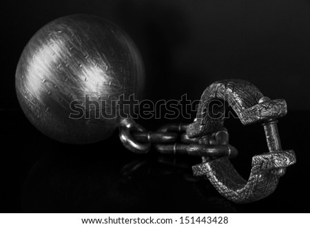 Ball and chain on black background - stock photo