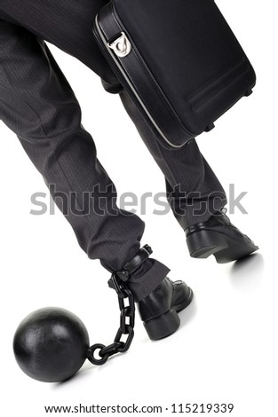 Ball and chain restraining a businessman as he walks away with a briefcase