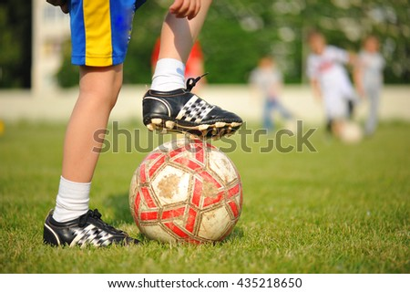 ball and  foot of the young player.