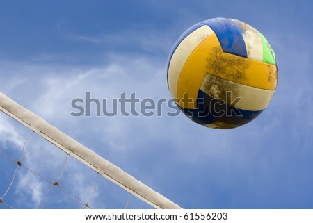 ball and net for beach volleyball with sky as background