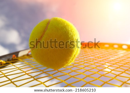 Ball and Racket against  sky - stock photo