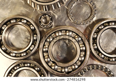 ball-bearings and pinions in titanium and steel, engineering concept in copper toning concept - stock photo