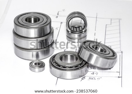 Ball bearings and Technical drawings for industry. - stock photo
