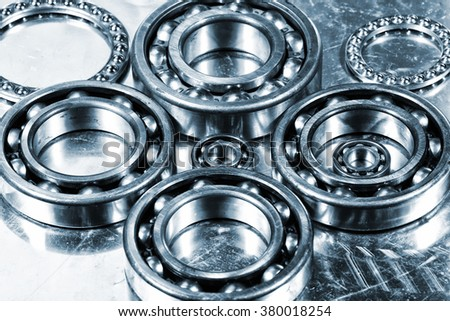 Ball bearings, titanium and steel aerospace parts in a metal blue toning concept - stock photo