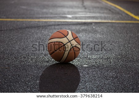 Ball for basketball on the court. Closeup with selective focus. Photo can be used as a whole background.