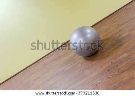 Ball for fitness in the interior gym workout. Sports equipment for woman and pregnant yoga training and pilates coaching .