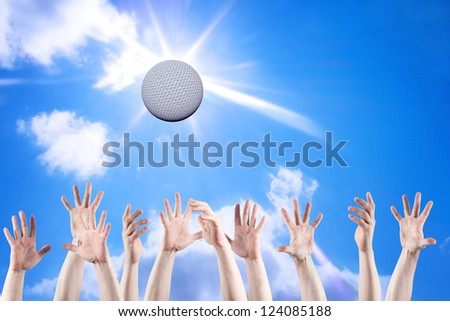 Ball game on the background of the sunny sky. - stock photo