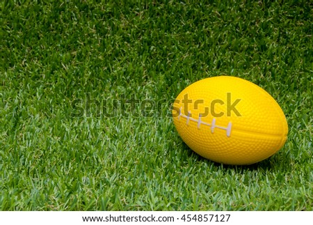 ball in grass with space for text