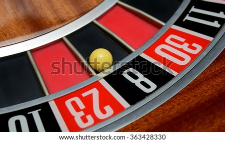 ball in winning number eight at roulette wheel - stock photo