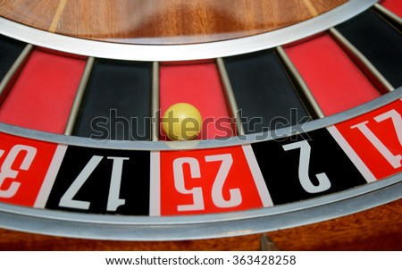 ball in winning number twenty five at roulette wheel - stock photo