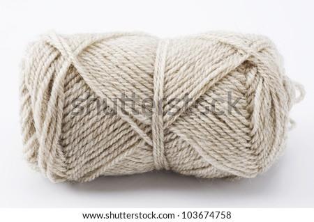 Ball of beige yarn on white background - stock photo