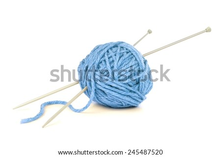 Ball of blue yarn with knitting needles isolated on white - stock photo