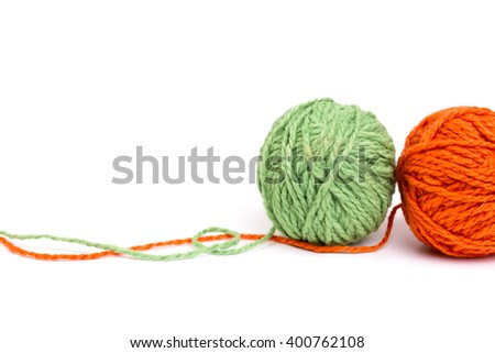 ball of green and orange wool yarns - isolated - stock photo