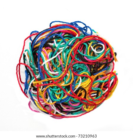 ball of multi-colored needlecraft thread isolated on white - stock photo