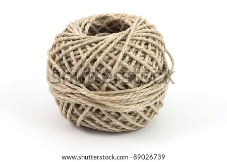Ball of parcel string with a white background - stock photo