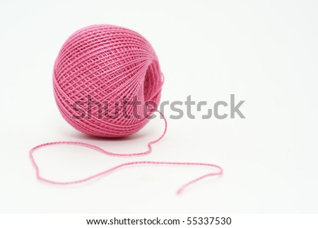 ball of pink cotton yarn isolated on white background - stock photo