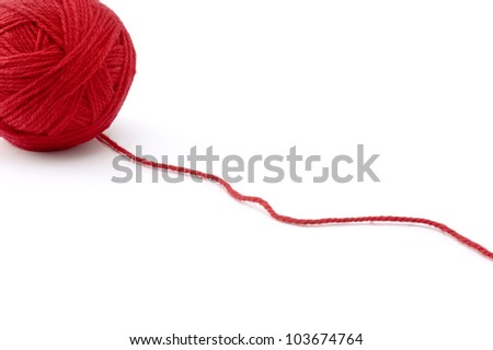 Ball of red yarn on white background - stock photo