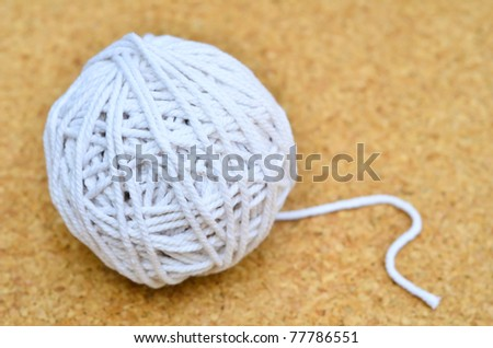 Ball Of White Rope Isolate On Cork Background