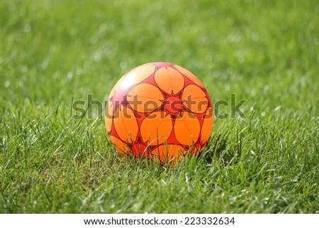 Ball on green field - stock photo