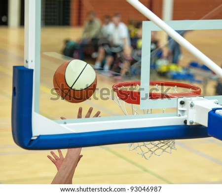Ball on its way to the basket - stock photo