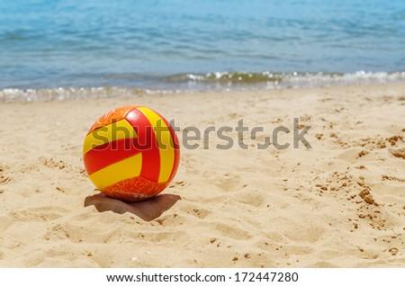 ball on sand near sea - stock photo