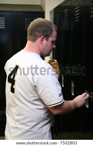 Ball Player Opening Locker After Game