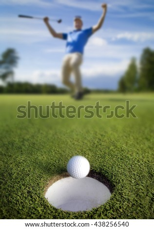Ball rolling into the hole - stock photo