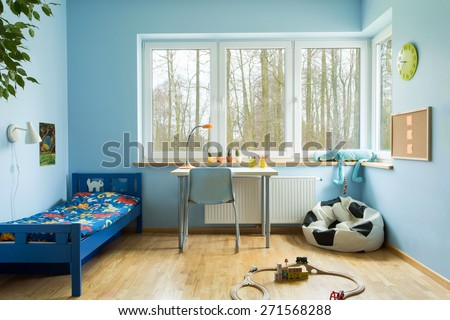 Ball shape sofa in boy toddler room  - stock photo