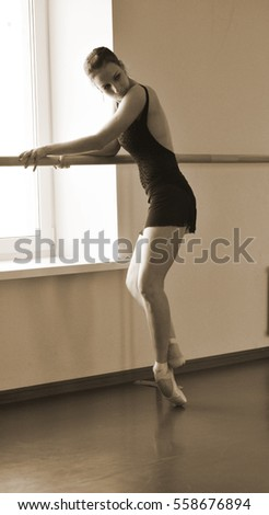 ballerina by the window to prepare for the performance
