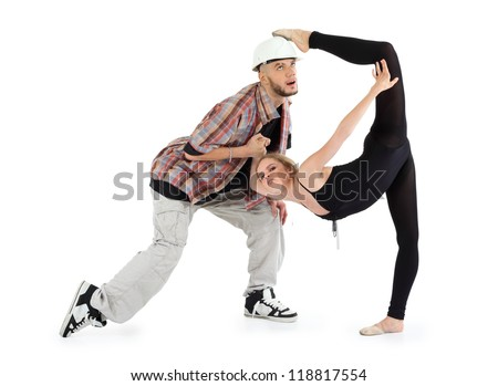 Ballerina in black put her foot on head of man and breakdancer in helmet holds her hand and rolls his eyes isolated on white background. - stock photo