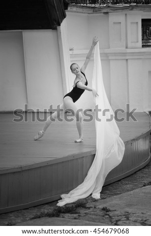 ballerina in summer theater with white fabric