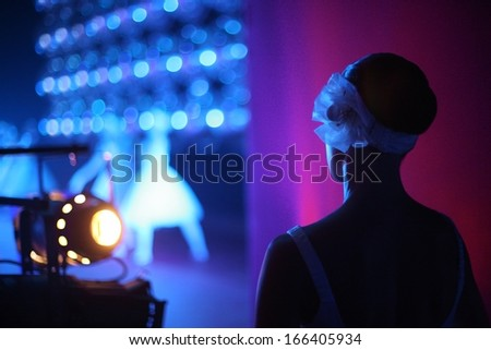 Ballerina on the backstage with a view of stage - stock photo
