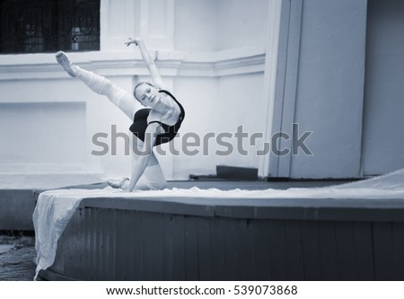ballerina on the stage with white fabric