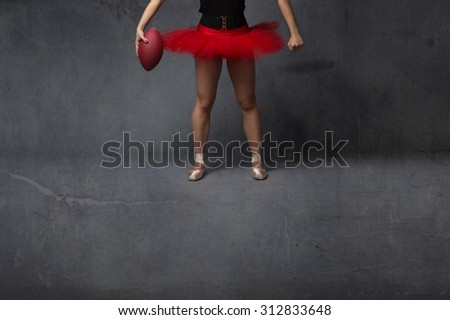 ballerina or football player close up, dark background - stock photo