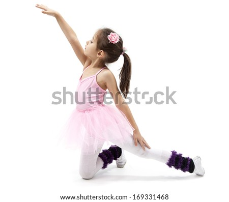 ballerina posing in front of a white background - stock photo
