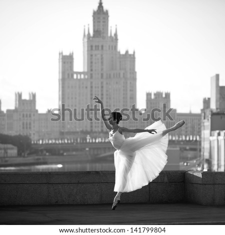 Ballerina posing in the center of Moscow - stock photo