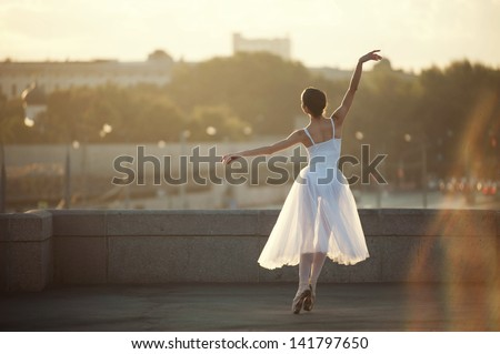 Ballerina posing in the center of Moscow city - stock photo
